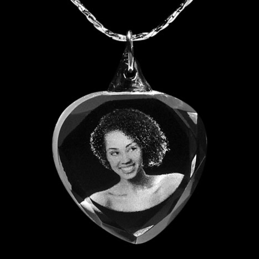 A personalised engraved photo pendant.